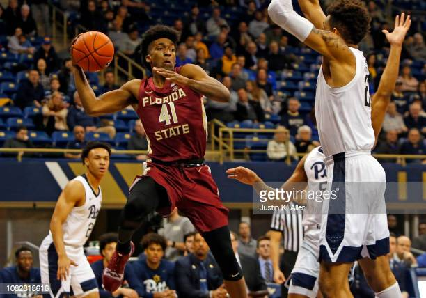 Terance Mann of the Florida State Seminoles looks to pass against the Pittsburgh Panthers at Petersen Events Center on January 14 2019 in Pittsburgh...
