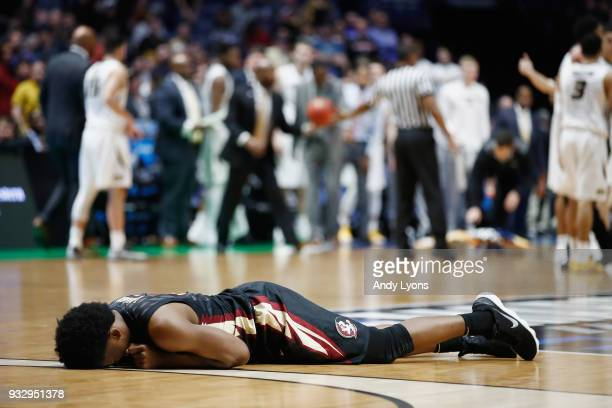 Terance Mann of the Florida State Seminoles reacts after being injured against the Missouri Tigers during the game in the first round of the 2018...
