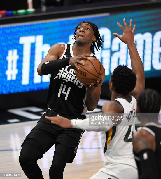 Terance Mann of the Los Angeles Clippers goes up for a layup against Donovan Mitchell of the Utah Jazz during the second half in Game Six of the...