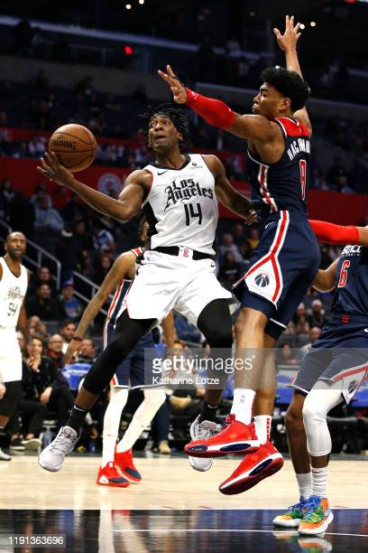 Terance Mann of the Los Angeles Clippers takes a shot as Rui Hachimura of the Washington Wizards defends during the second half at Staples Center on...