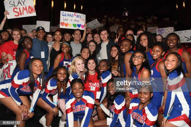 "Terayle Hill, Alexandra Shipp, Greg Berlanti, Becky Albertalli, and Nick Robinson pose with movie audience at ""Love, Simon"" Atlanta Fan Screening and..."