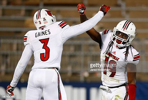 Terell Floyd and Charles Gaines of the Louisville Cardinals celebrate following Floyd's interception in the endzone in the fourth quarter against the...