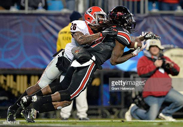 Terell Floyd of the Louisville Cardinals intercepts a pass intended for Malcolm Mitchell of the Georgia Bulldogs during the Belk Bowl at Bank of...