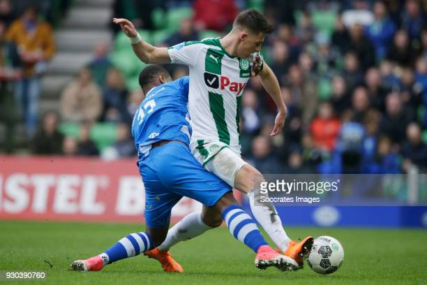 Terell Ondaan of PEC Zwolle Ajdin Hrustic of FC Groningen during the Dutch Eredivisie match between FC Groningen v PEC Zwolle at the NoordLease...