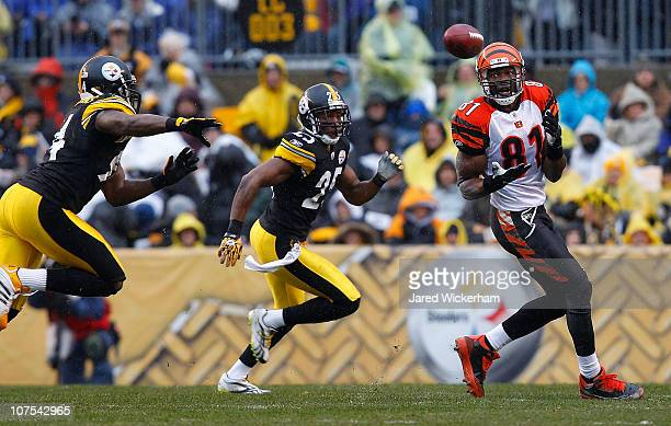 Terell Owens of the Cincinnati Bengals catches a pass in front of Ryan Clark of the Pittsburgh Steelers during the game on December 12 2010 at Heinz...