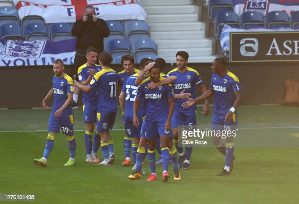 Terell Thomas of AFC Wimbledon celebrates after scoring his team's second goal with team mates during the EFL Trophy match AFC Wimbledon and Charlton...