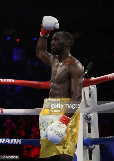 Terence Crawford celebrates his sixth round stoppage due to a low blow against Amir Khan during their WBO welterweight title fight at Madison Square...