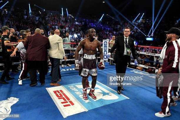 Terence Crawford celebrates his victory after a TKO in the 9th round during the WBO welterweight title between Jeff Horn and Terence Crawford at MGM...