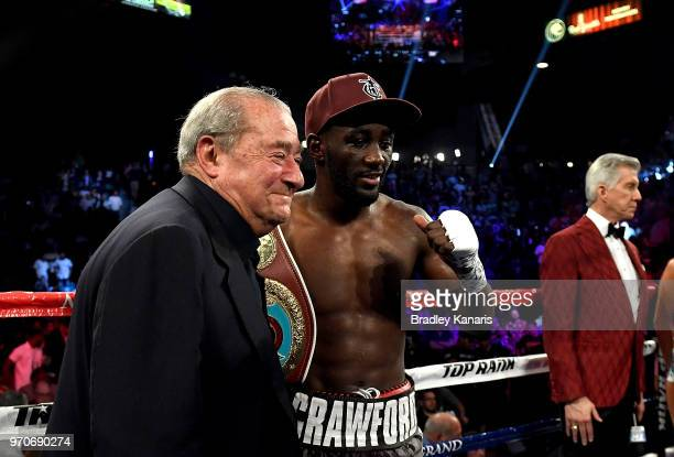 Terence Crawford celebrates his victory after a TKO in the 9th round with Top Rank boxing promoter Bob Arum after the WBO welterweight title between...