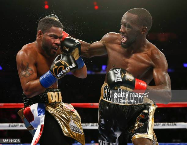 Terence Crawford connects with Felix Diaz during their WBO/WBC junior welterweight title bout at Madison Square Garden on May 20 2017 in New York City