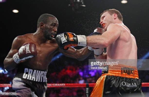 Terence Crawford hits Jeff Horn in the ninth round of their WBO welterweight title fight at MGM Grand Garden Arena on June 9 2018 in Las Vegas Nevada...