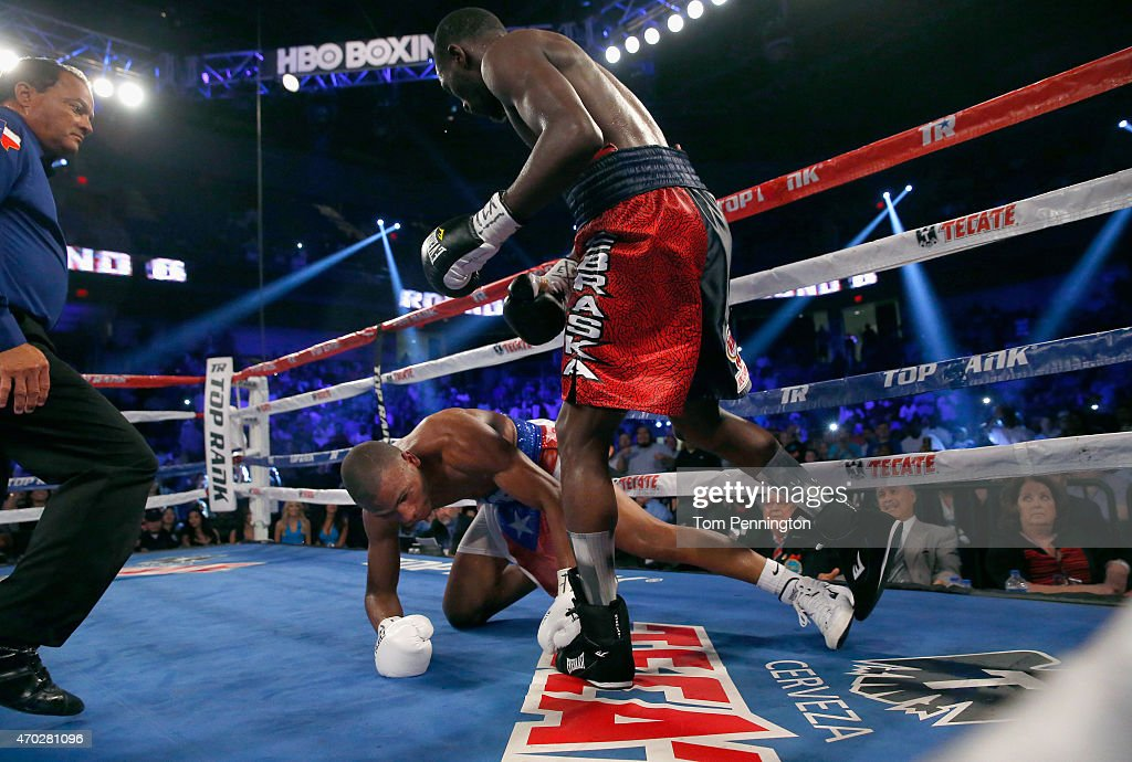 Terence Crawford knocks down Thomas Dulorme of Puerto Rico in the sixth round in their WBO Jr. Welterweight Title Bout on April 18, 2015 in Arlington, Texas.