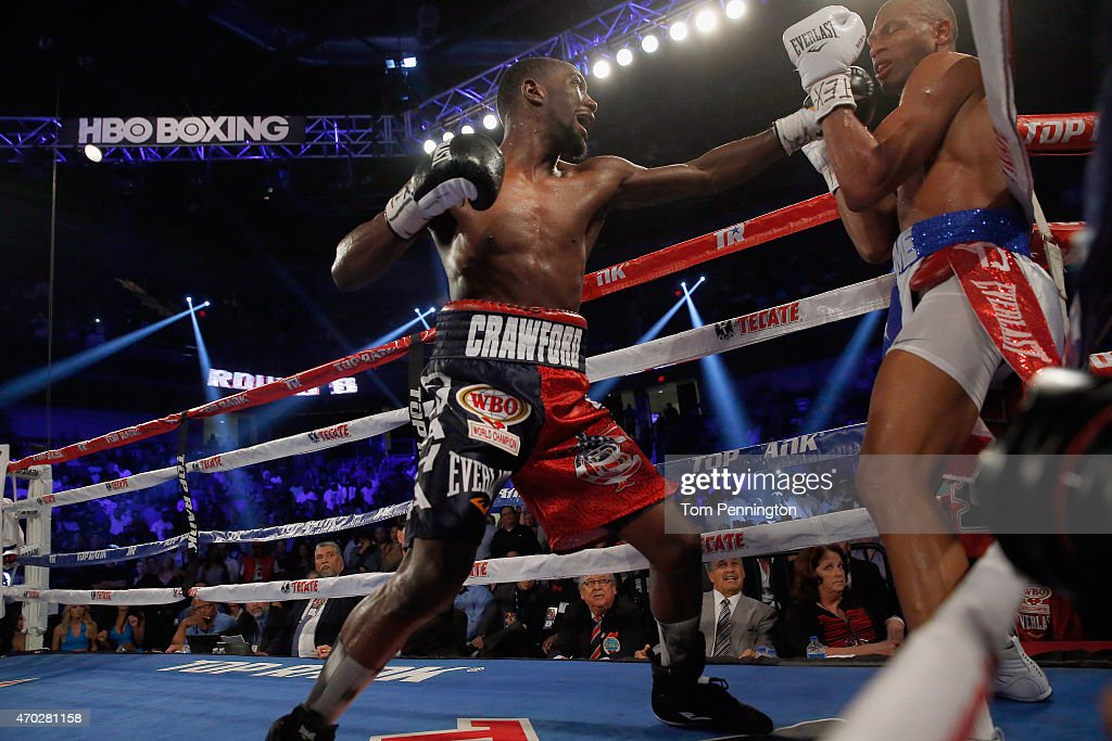 Terence Crawford lands a punch Thomas Dulorme of Puerto Rico in the sixth round in their WBO Jr. Welterweight Title Bout on April 18, 2015 in Arlington, Texas.