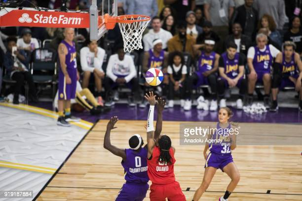 Terence Crawford of Team Lakers and Quavo of Team Clippers vie for a rebound during the 2018 NBA AllStar Celebrity Game as part of AllStar Weekend at...