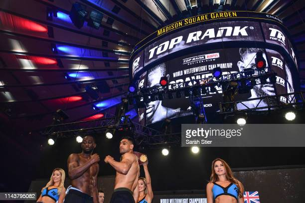 Terence Crawford poses with Amir Khan of the United Kingdom during the weighin for their welterweights fight against at Madison Square Garden on...