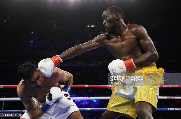Terence Crawford punches Amir Khan during their WBO welterweight title fight at Madison Square Garden on April 20 2019 in New York City