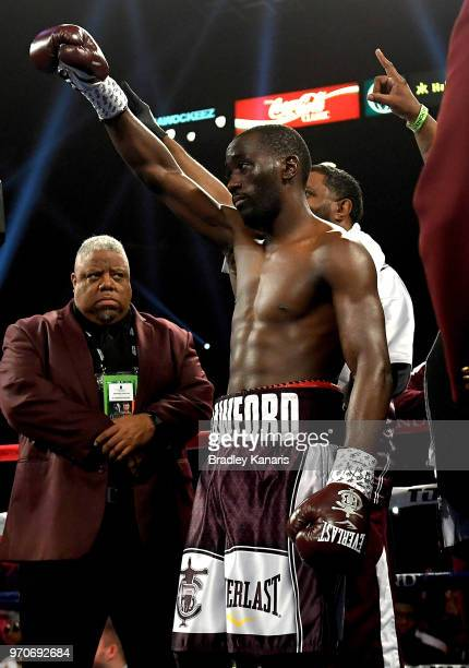 Terence Crawford raises his arm as his name is called before the start of his WBO welterweight title fight against Jeff Horn at MGM Grand Garden...