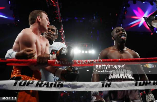 Terence Crawford sticks his tongue out as he celebrates his ninthround TKO victory over Jeff Horn who is held by referee Robert Byrd at the end of...