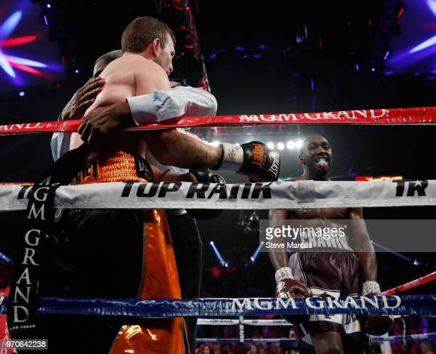 Terence Crawford sticks his tongue out as he celebrates his ninth-round TKO victory over Jeff Horn who is held by referee Robert Byrd at the end of...