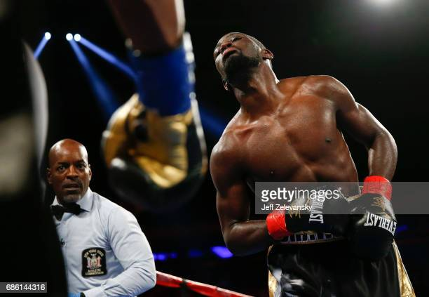 Terence Crawford taunts Felix Diaz as referee Steve Willis looks on during their WBO/WBC junior welterweight title bout at Madison Square Garden on...
