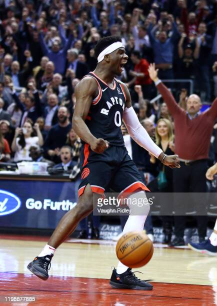 Terence Davis II of the Toronto Raptors celebrates victory at the final whistle of an NBA game against the Indiana Pacers at Scotiabank Arena on...