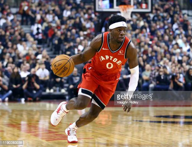 Terence Davis II of the Toronto Raptors dribbles the ball during the first half of an NBA game against the Philadelphia 76ers at Scotiabank Arena on...
