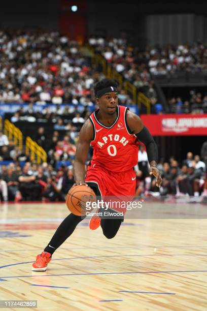 Terence Davis II of the Toronto Raptors drives against the Houston Rockets as part of the 2019 NBA Japan Games at Super Saitama Arena on October 8...