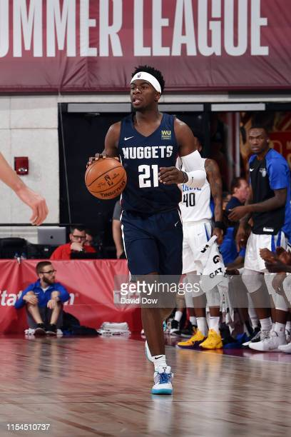 Terence Davis of the Denver Nuggets handles the ball during the game against the Orlando Magic during Day 3 of the 2019 Las Vegas Summer League on...