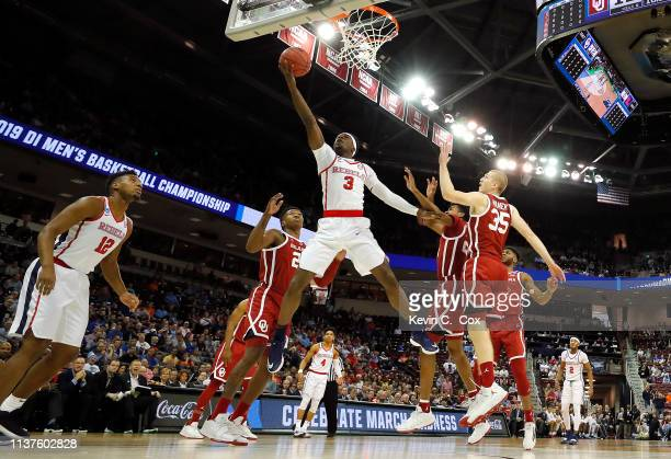 Terence Davis of the Mississippi Rebels drives to the basket against Brady Manek of the Oklahoma Sooners in the first half during the first round of...