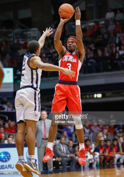 Terence Davis of the Mississippi Rebels shoots the ball against Aaron Thompson of the Butler Bulldogs at Hinkle Fieldhouse on November 16 2018 in...