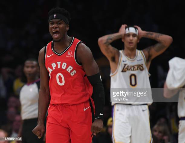 Terence Davis of the Toronto Raptors celebrates his three pointer in front of Kyle Kuzma of the Los Angeles Lakers during a 113104 win over the...