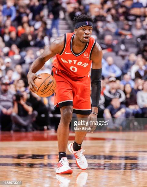 Terence Davis of the Toronto Raptors dribbles against the Charlotte Hornets during their NBA basketball game at Scotiabank Arena on November 18 2019...