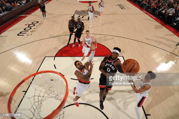Terence Davis of the Toronto Raptors drives to the basket against the Portland Trail Blazers on November 13 2019 at the Moda Center Arena in Portland...