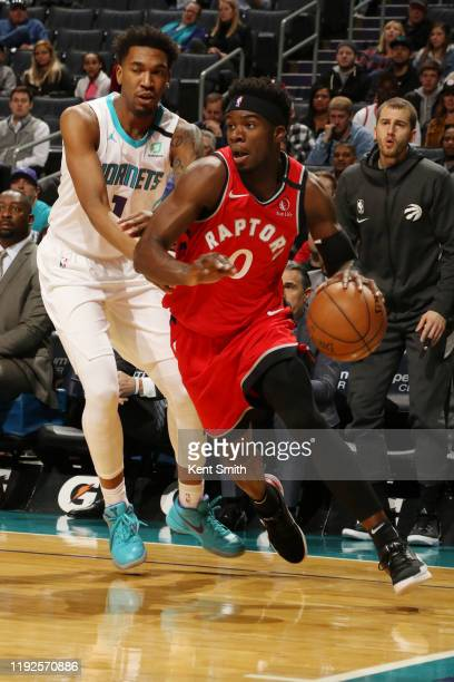 Terence Davis of the Toronto Raptors drives to the basket against the Charlotte Hornets on January 8 2020 at Spectrum Center in Charlotte North...