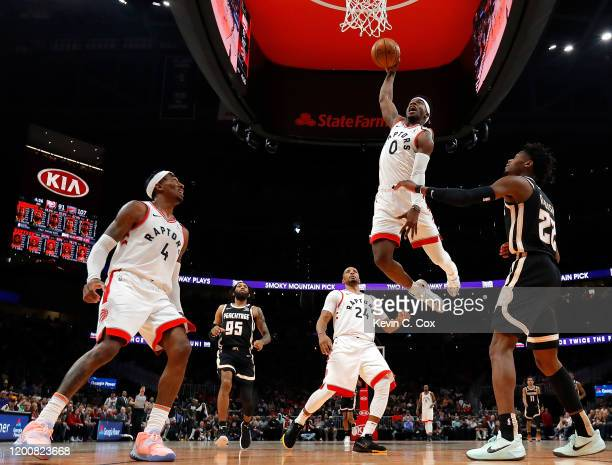 Terence Davis of the Toronto Raptors dunks against Cam Reddish of the Atlanta Hawks in the second half at State Farm Arena on January 20 2020 in...