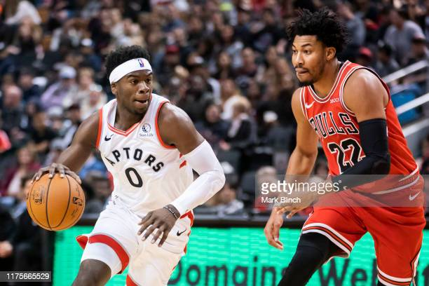 Terence Davis of the Toronto Raptors goes to the basket against Otto Porter Jr #22 of the Chicago Bulls during their NBA basketball preseason game at...