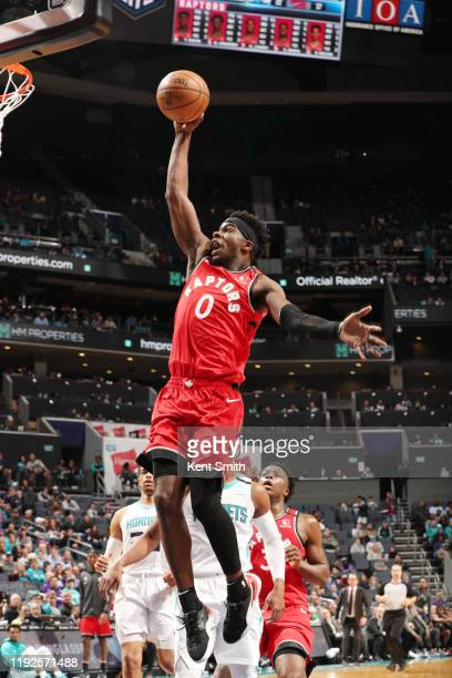 Terence Davis of the Toronto Raptors goes up for a dunk during the game against the Charlotte Hornets on January 8 2020 at Spectrum Center in...