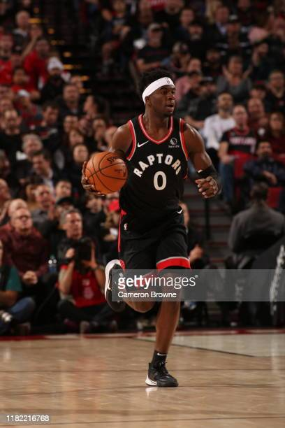Terence Davis of the Toronto Raptors handles the ball against the Portland Trail Blazers on November 13 2019 at the Moda Center Arena in Portland...