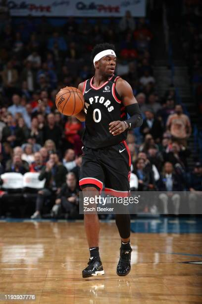 Terence Davis of the Toronto Raptors handles the ball against the Oklahoma City Thunder on January 15 2020 at Chesapeake Energy Arena in Oklahoma...
