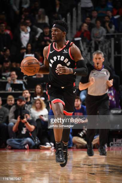 Terence Davis of the Toronto Raptors handles the ball against the Detroit Pistons on January 31 2020 at Little Caesars Arena in Detroit Michigan NOTE...