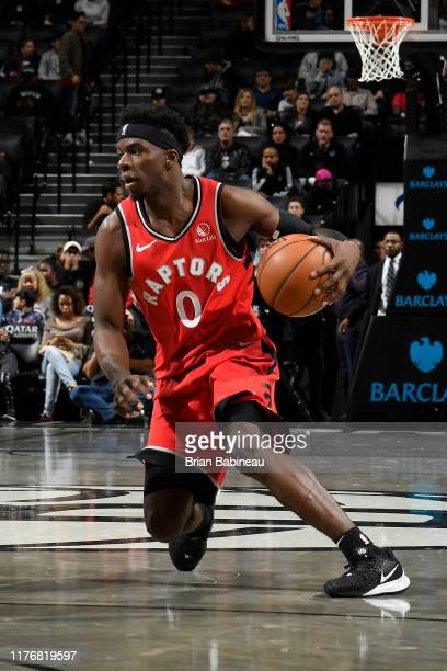 Terence Davis of the Toronto Raptors handles the ball during a preseason game against the Brooklyn Nets on October 18 2019 at the Barclays Center in...