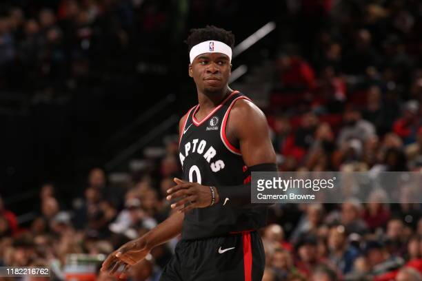 Terence Davis of the Toronto Raptors looks on during the game against the Portland Trail Blazers on November 13 2019 at the Moda Center Arena in...