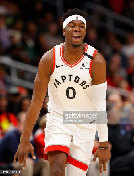 Terence Davis of the Toronto Raptors reacts after hitting a threepoint basket against the Atlanta Hawks in the second half at State Farm Arena on...