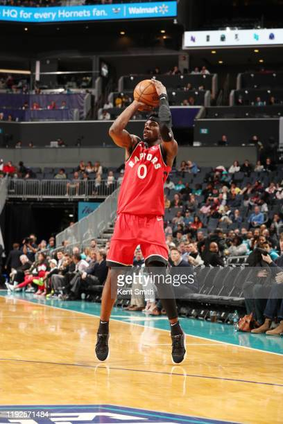 Terence Davis of the Toronto Raptors shoots a three point basket during the game against the Charlotte Hornets on January 8 2020 at Spectrum Center...