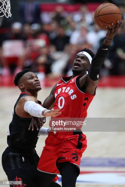 Terence Davis of Toronto Raptors drives to the basket against Russell Westbrook of Houston Rockets during the preseason match between Toronto Raptors...