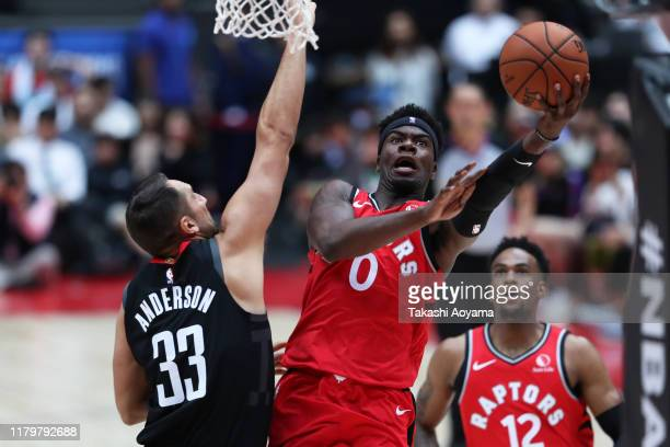Terence Davis of Toronto Raptors drives to the basket against Ryan Anderson of Houston Rockets during the preseason game between Houston Rockets and...