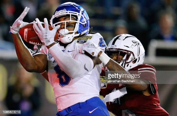 Terence Dunlap of the Troy Trojans breaks up a pass intended for KJ Osborn of the Buffalo Bulls during the first half of the Dollar General Bowl on...