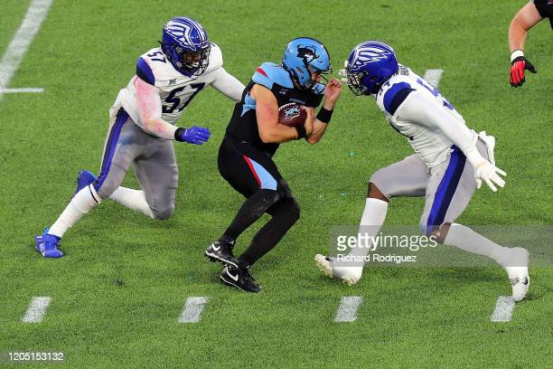 Terence Garvin and Dewayne Hendrix of the St Louis Battlehawks close in on Philip Nelson of the Dallas Renegades in the third quarter of an XFL Game...