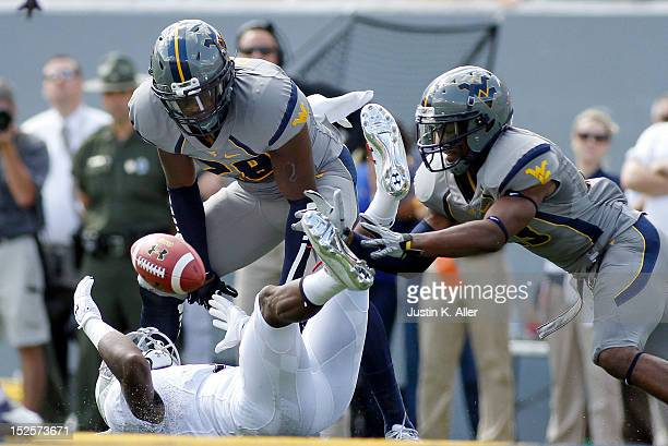 Terence Garvin and KJ Dillon of the West Virginia Mountaineers break up a pass intended for Stefon Diggs of the Maryland Terrapins during the game on...
