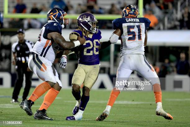 Terence Garvin of Orlando Apollos intercepts the ball for a 51yard touchdown on a ball tipped out of the hands of Tarean Folston of Atlanta Legends...